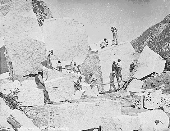 Workers at the granite quarry in Little Cottonwood Canyon prepare stones for use in the Salt Lake Temple of The Church of Jesus Christ of Latter-day Saints in 1872.