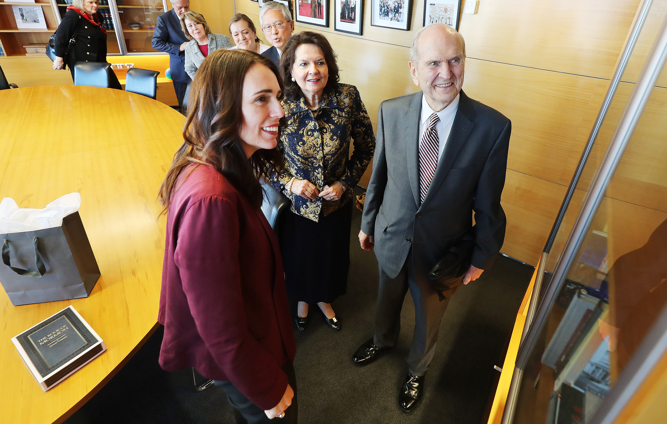 President Russell M. Nelson of The Church of Jesus Christ of Latter-day Saints and his wife, Sister Wendy Nelson, look over office-displayed items with New Zealand Prime Minister Jacinda Ardern in Wellington, New Zealand, on Monday May 20, 2019.