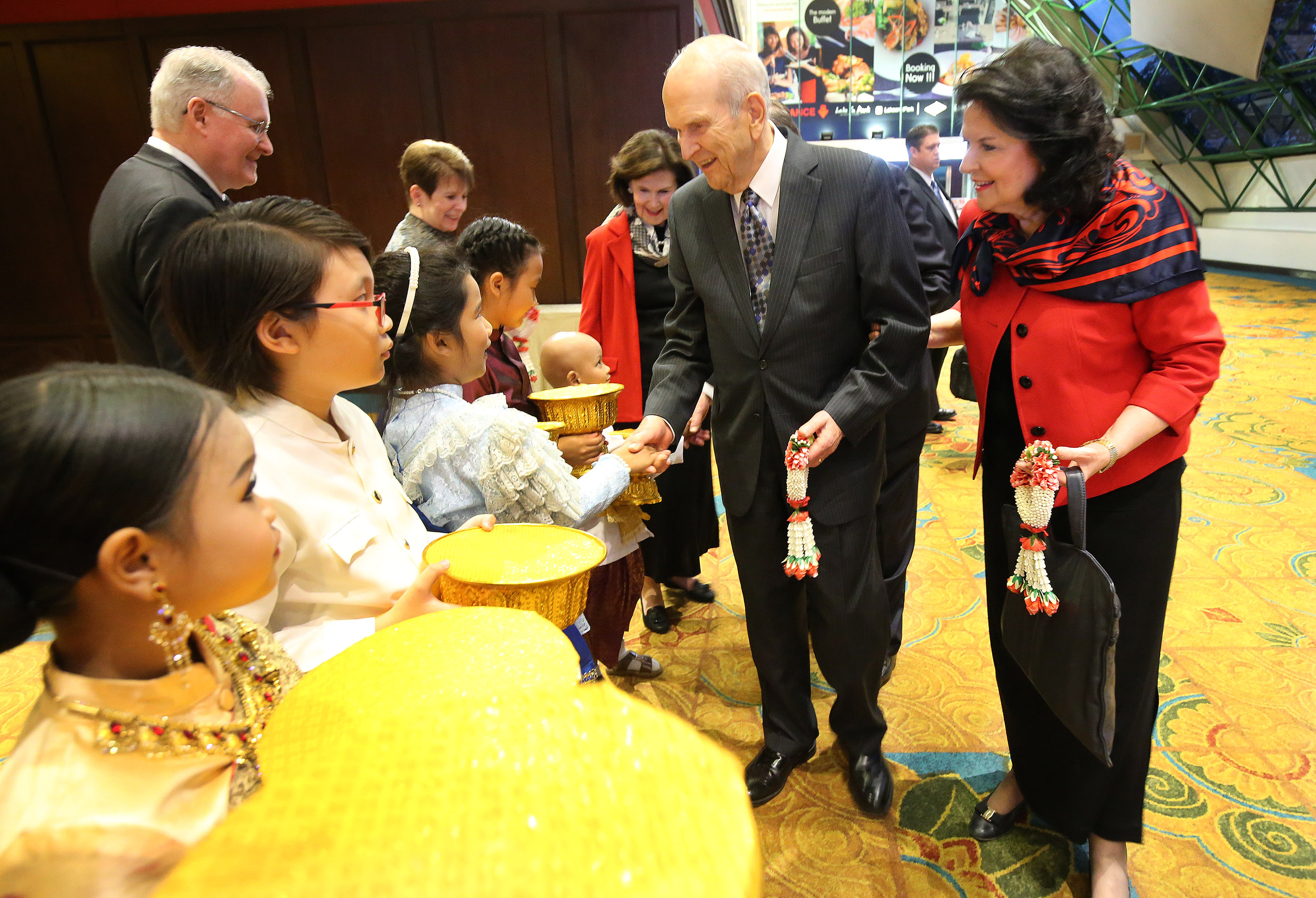President Russell M. Nelson and his wife, Sister Wendy Nelson, are greeted and given flowers by primary children in Bangkok, Thailand, on Friday, April 20, 2018.