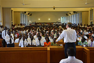 Elder David A. Bednar speaks to members during a meeting held in Accra, Ghana.