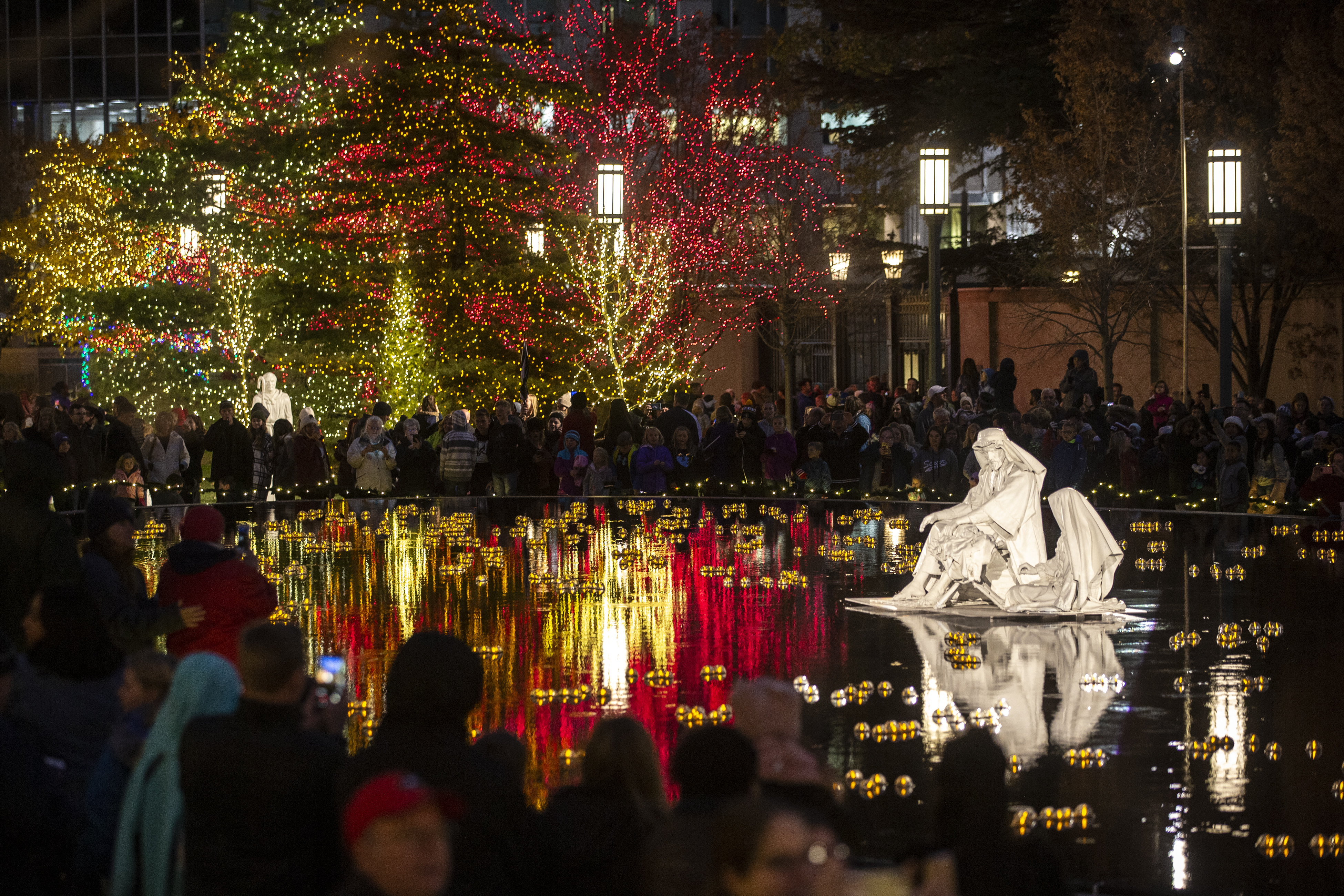 Thousands take in the colors as the lights are turned on at Temple Square in Salt Lake City on Friday, Nov. 23, 2018.