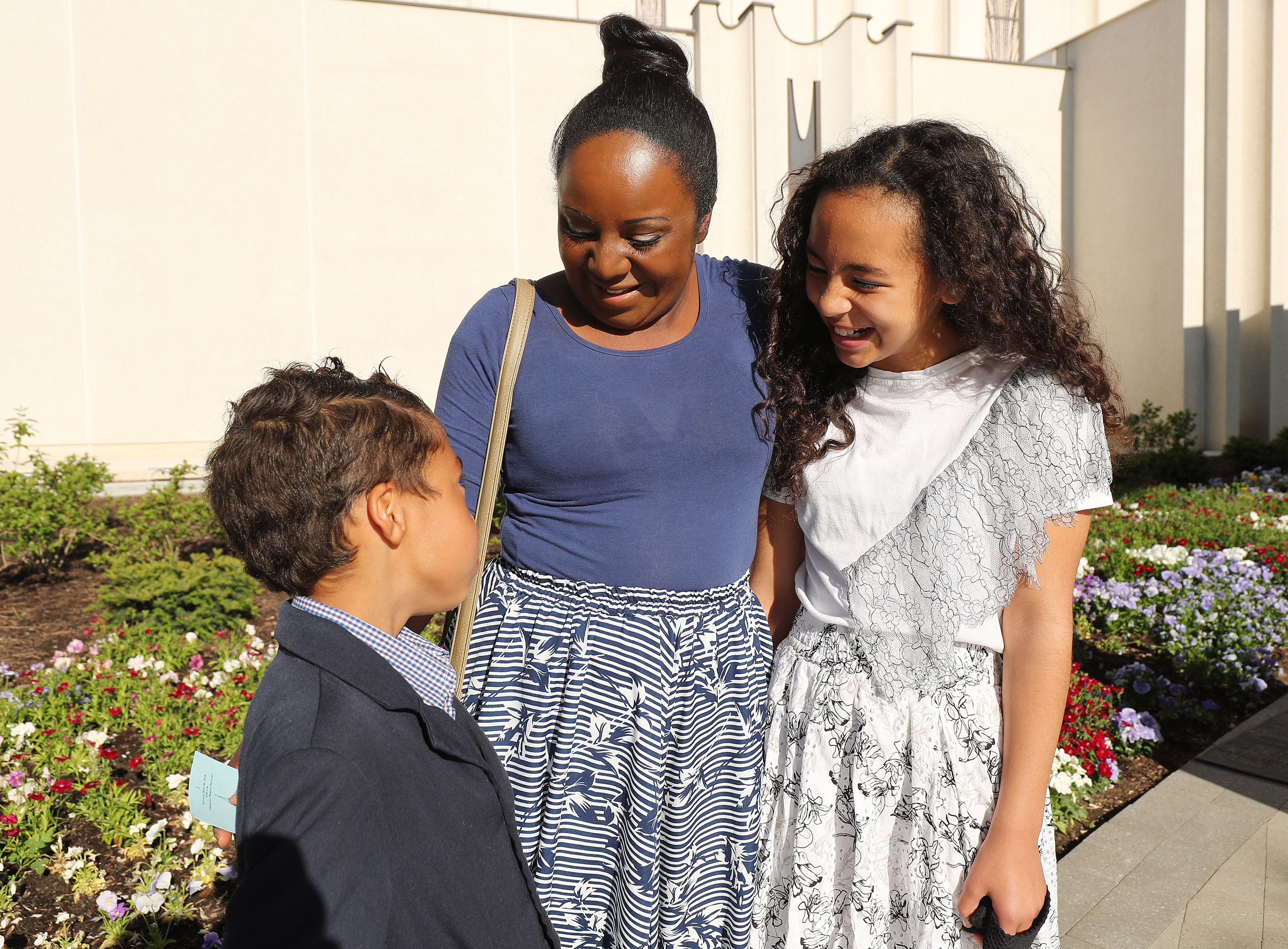 Ana Lewis talks with her children Moriah and Shane as the Jordan River Utah Temple is rededicated in South Jordan on Sunday, May 20, 2018.