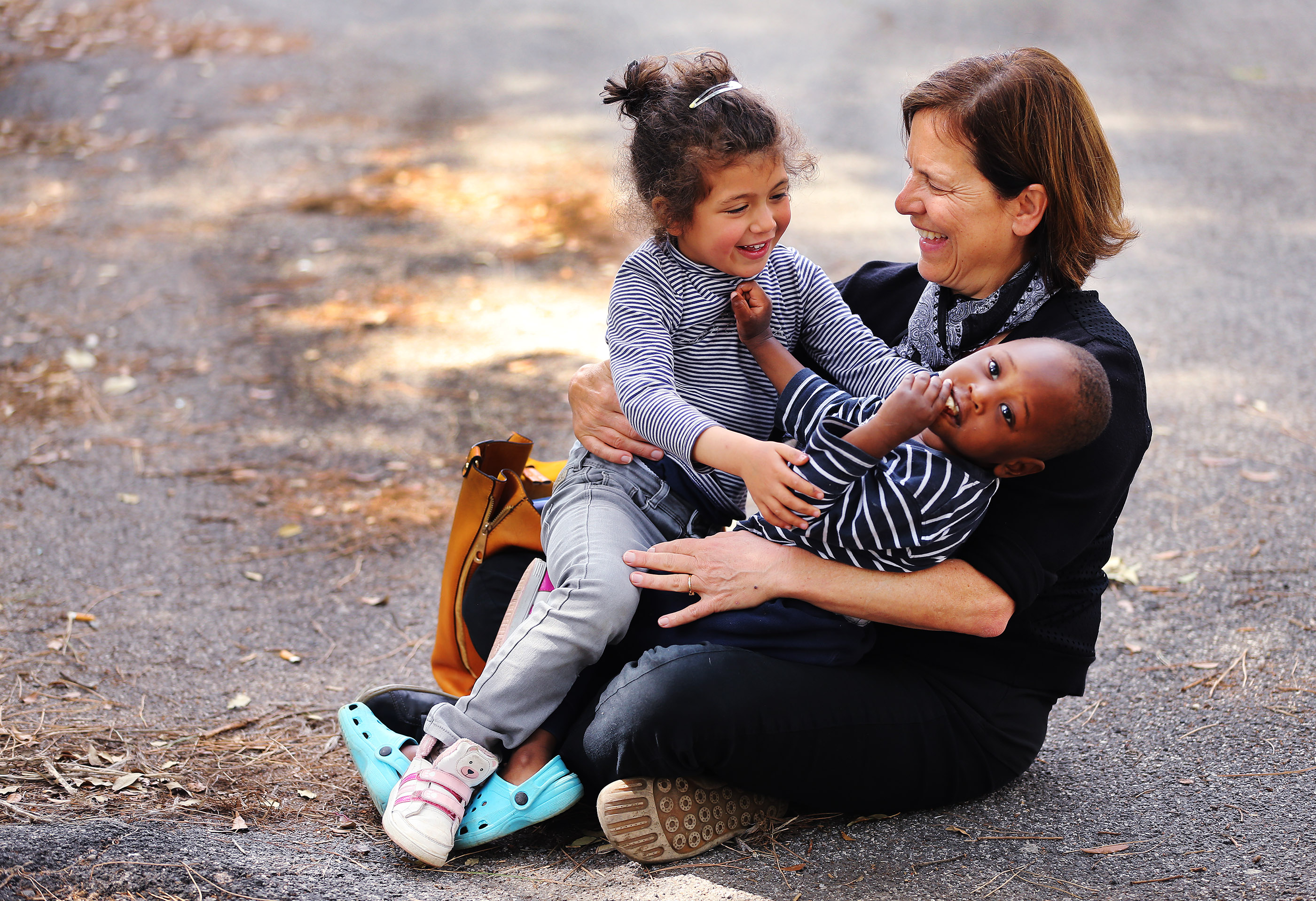 Latter-day Saint Charities missionary Anita Herway plays with Malek and Momo Mana at INTERSOS in Rome, Italy, on Tuesday, April 17, 2018. Latter-day Saint Charities contributed money to the organization.