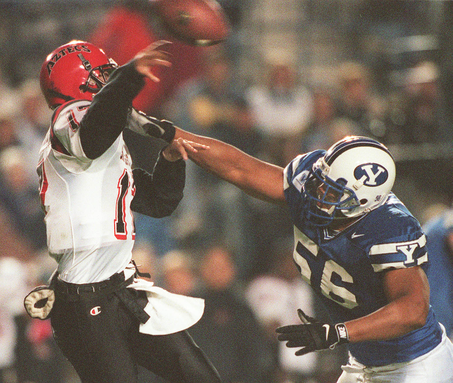 BYU's Ed Kehl hurries San Diego State QB Brian Russell to help cause an incompletion during a game in 1998.