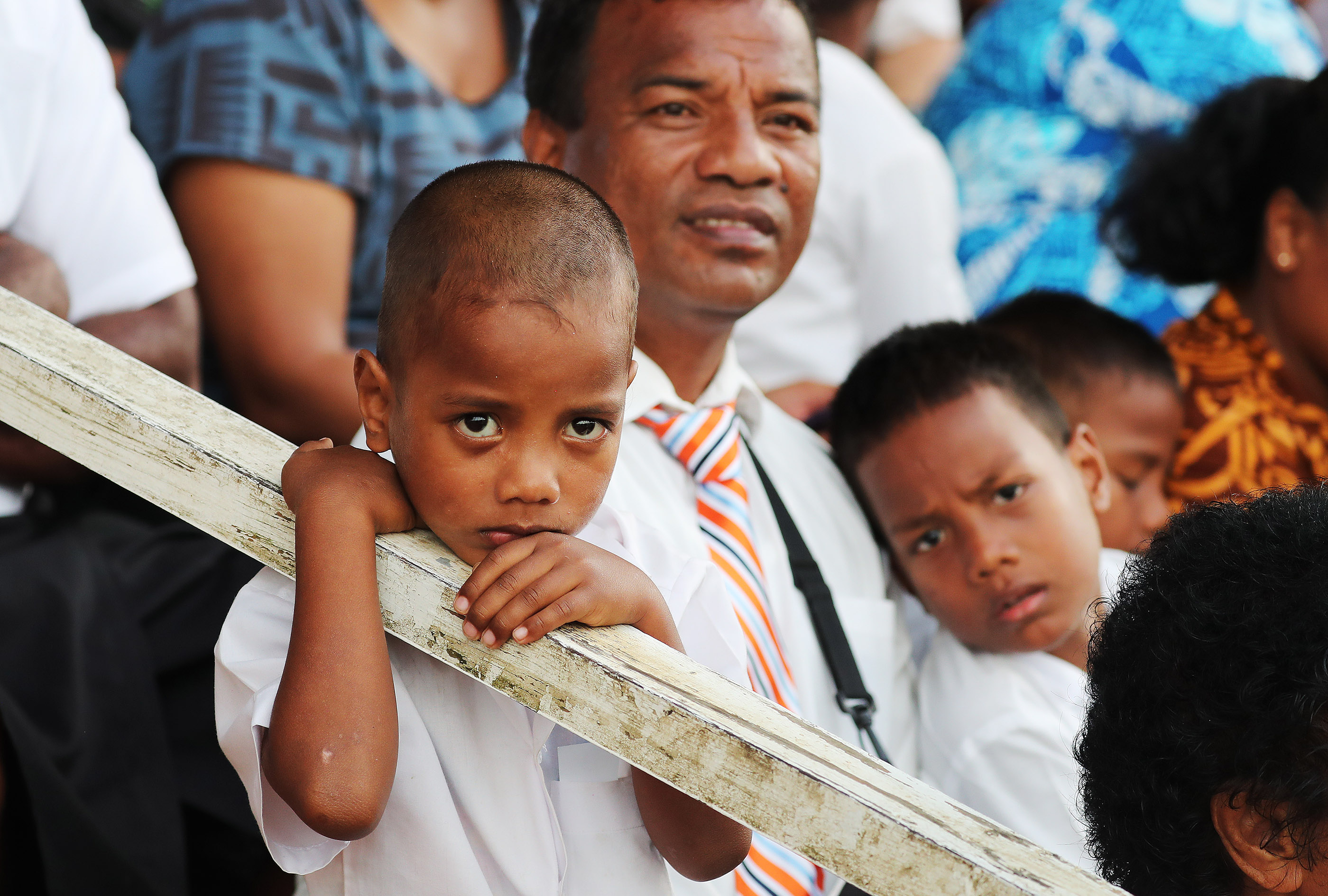 A family watches President Russell M. Nelson of The Church of Jesus Christ of Latter-day Saints speak during a devotional at Ratu Cakobau Park stadium in Nausori, Fiji, on May 22, 2019.