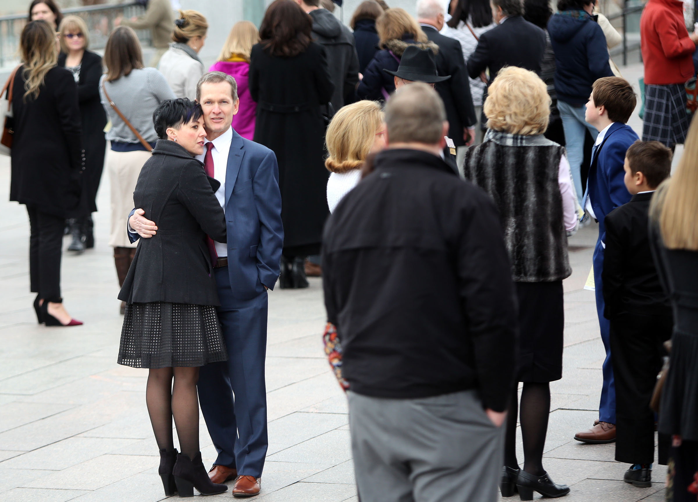 People line up outside the Conference Center for President Thomas S. Monson's funeral in Salt Lake City on Friday, Jan. 12, 2018.