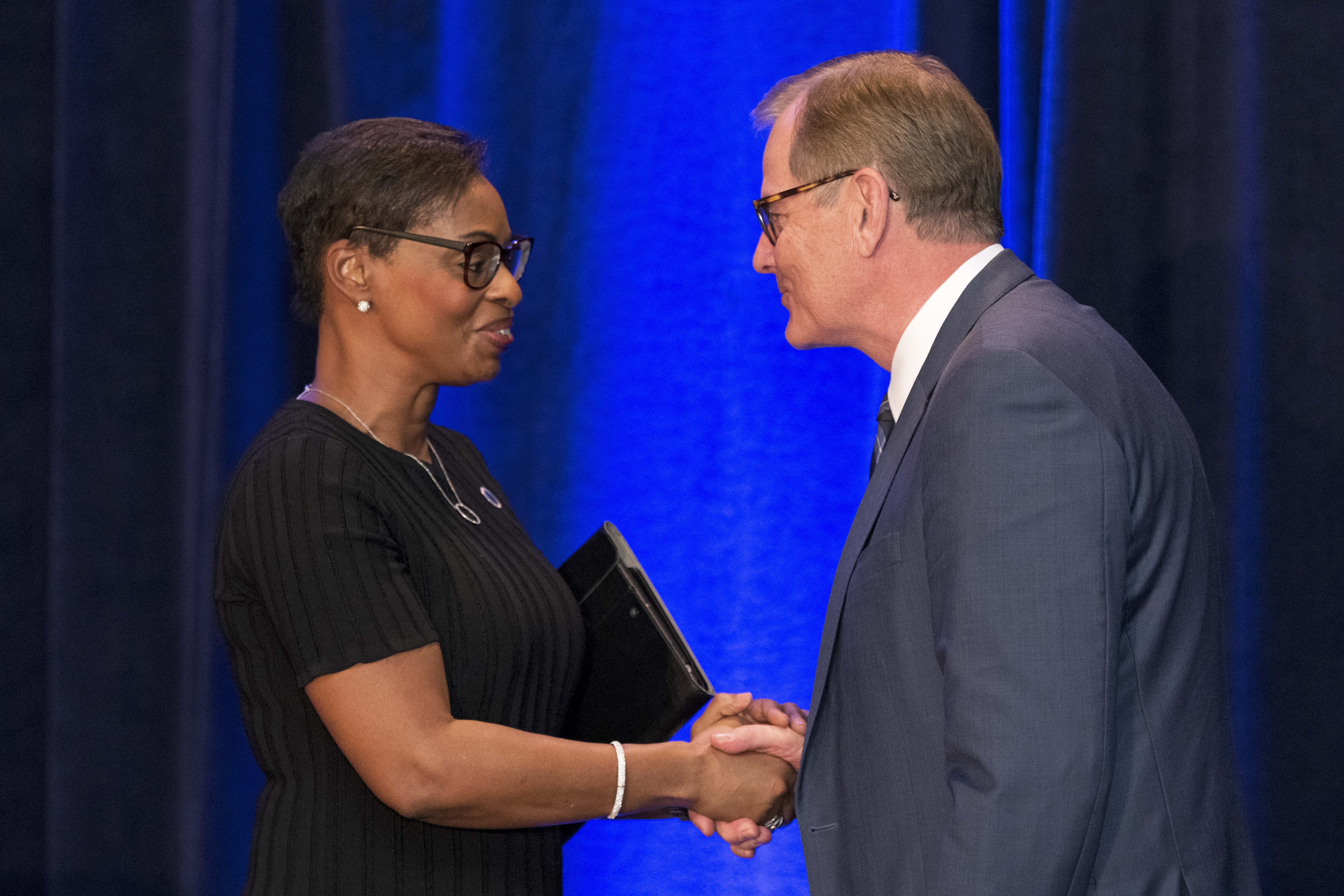Elder Gary E. Stevenson congratulates Karen Boykin-Towns, NAACP vice chair, on receiving the award from the BYU Management Society event on May 11, 2019.