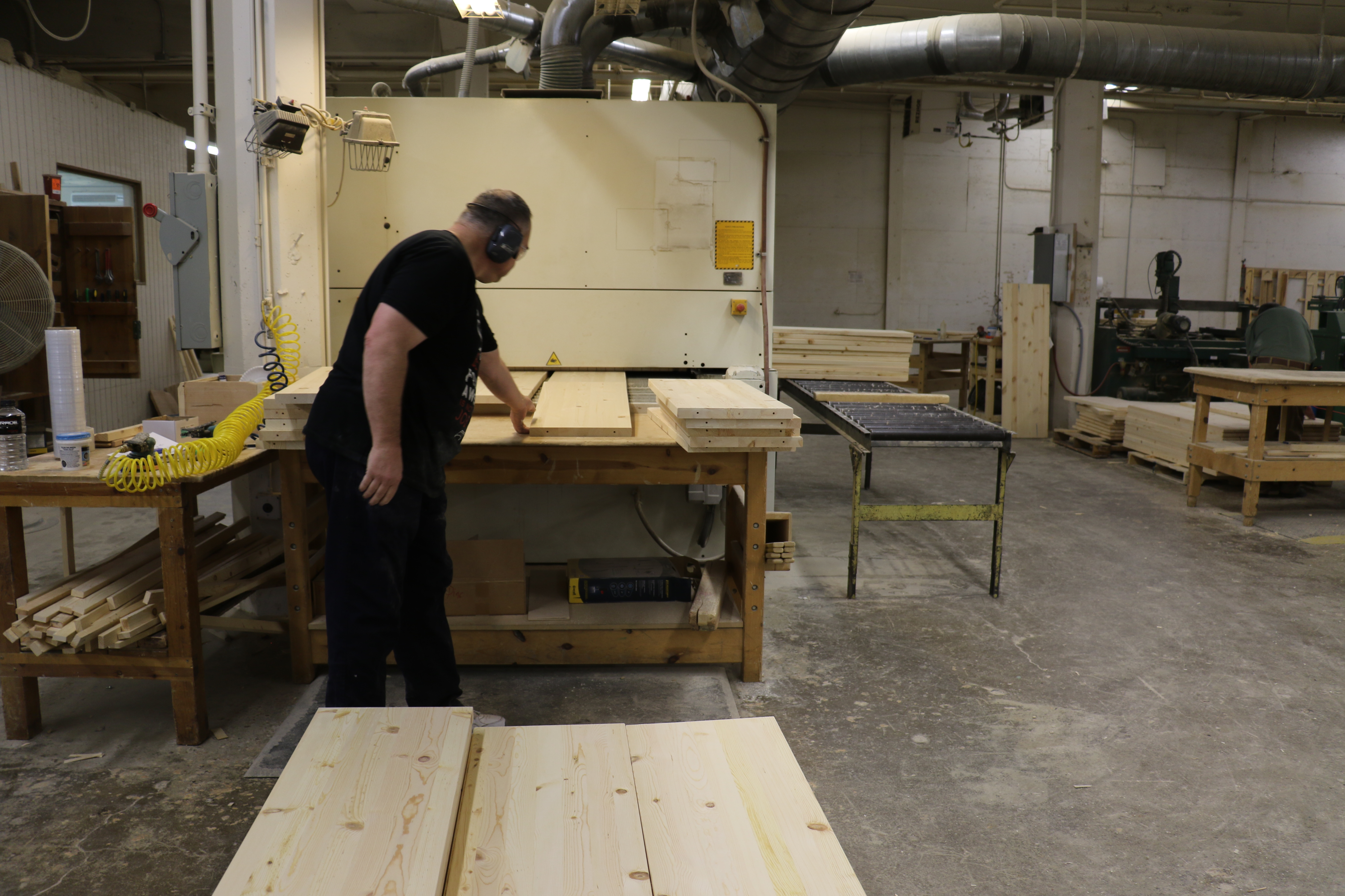 An employee helps in building furniture to be sold at Deseret Industries.