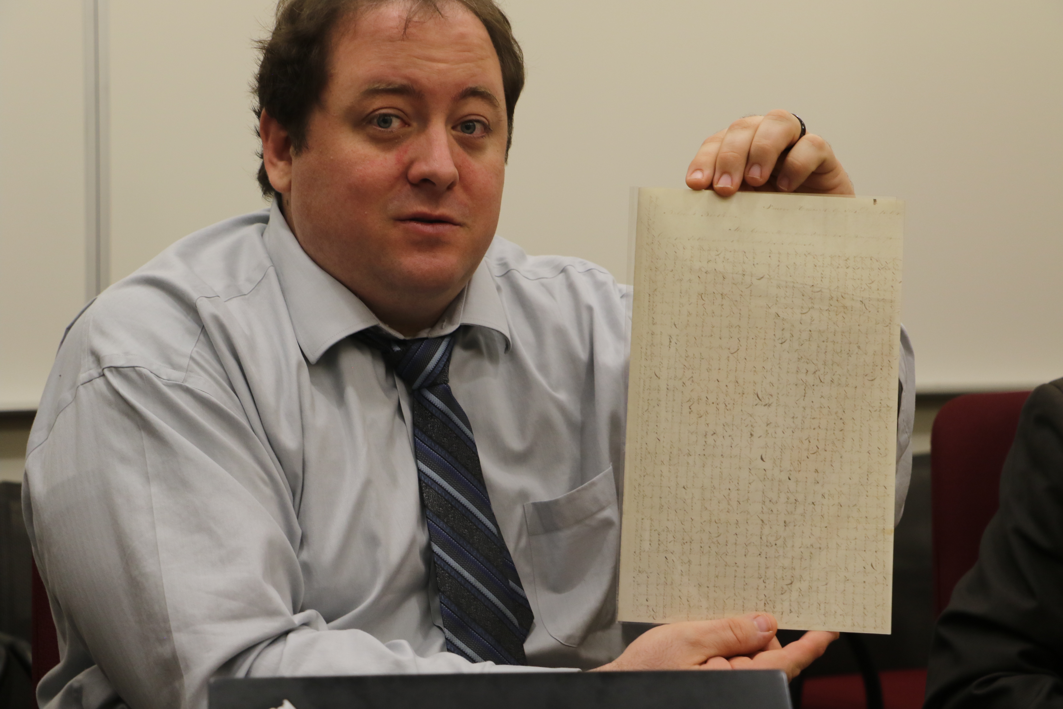 Christopher J. Blythe, volume editor, displays cross-written letter sent by Joseph Smith to members of the Twelve serving missions in England. It is one of 129 documents contained in latest Joseph Smith Papers release.
