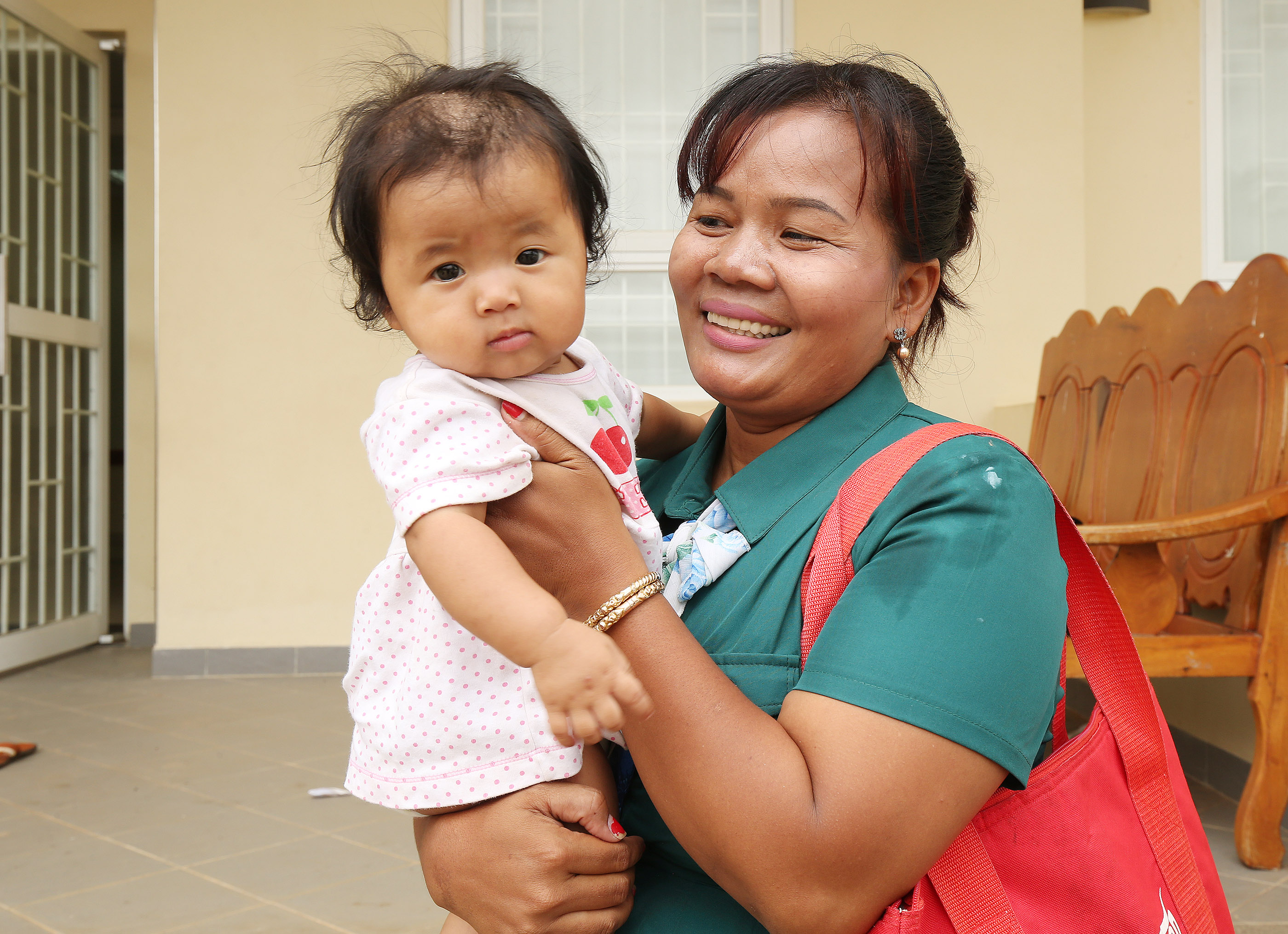 Kampong Thom branch member Somnang Pat holds her baby Dana after church in Cambodia on Apr 28, 2018.