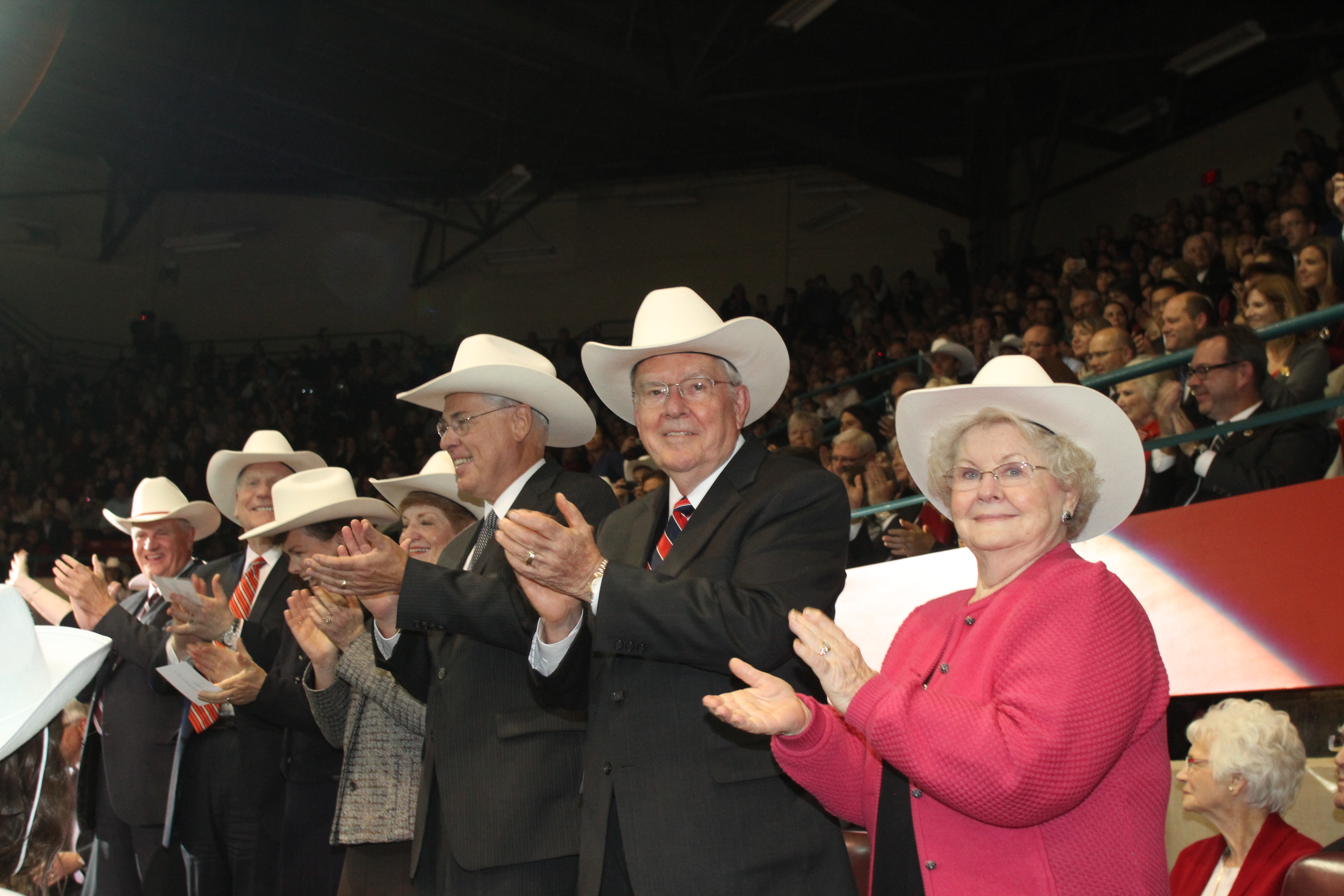 Elder M. Russell Ballard and his wife, Sister Barbara B. Ballard, at right, and other leaders were presented white hats as symbols of western hospitality and good cheer at the October 2012 youth celebration held in conjunction with the Calgary Alberta Canada dedication.