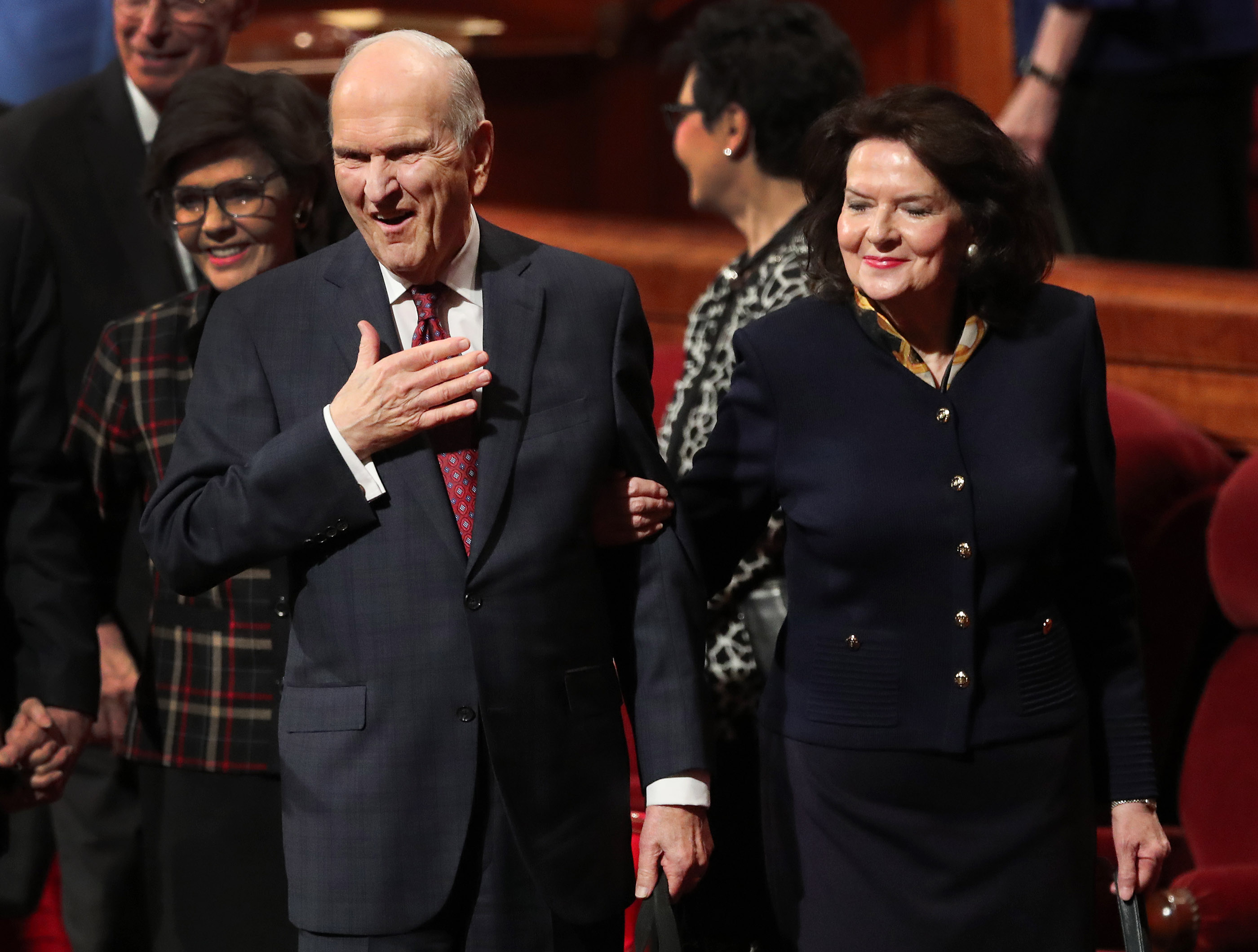 President Russell M. Nelson gestures to attendees along with his wife, Sister Wendy Nelson, after the Sunday afternoon session of the 188th Semiannual General Conference of The Church of Jesus Christ of Latter-day Saints in the Conference Center in downtown Salt Lake City on Sunday, Oct. 7, 2018.