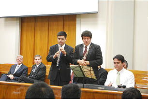 Aldo, left, and Nelson Lopez perform at devotional where both received oboes.