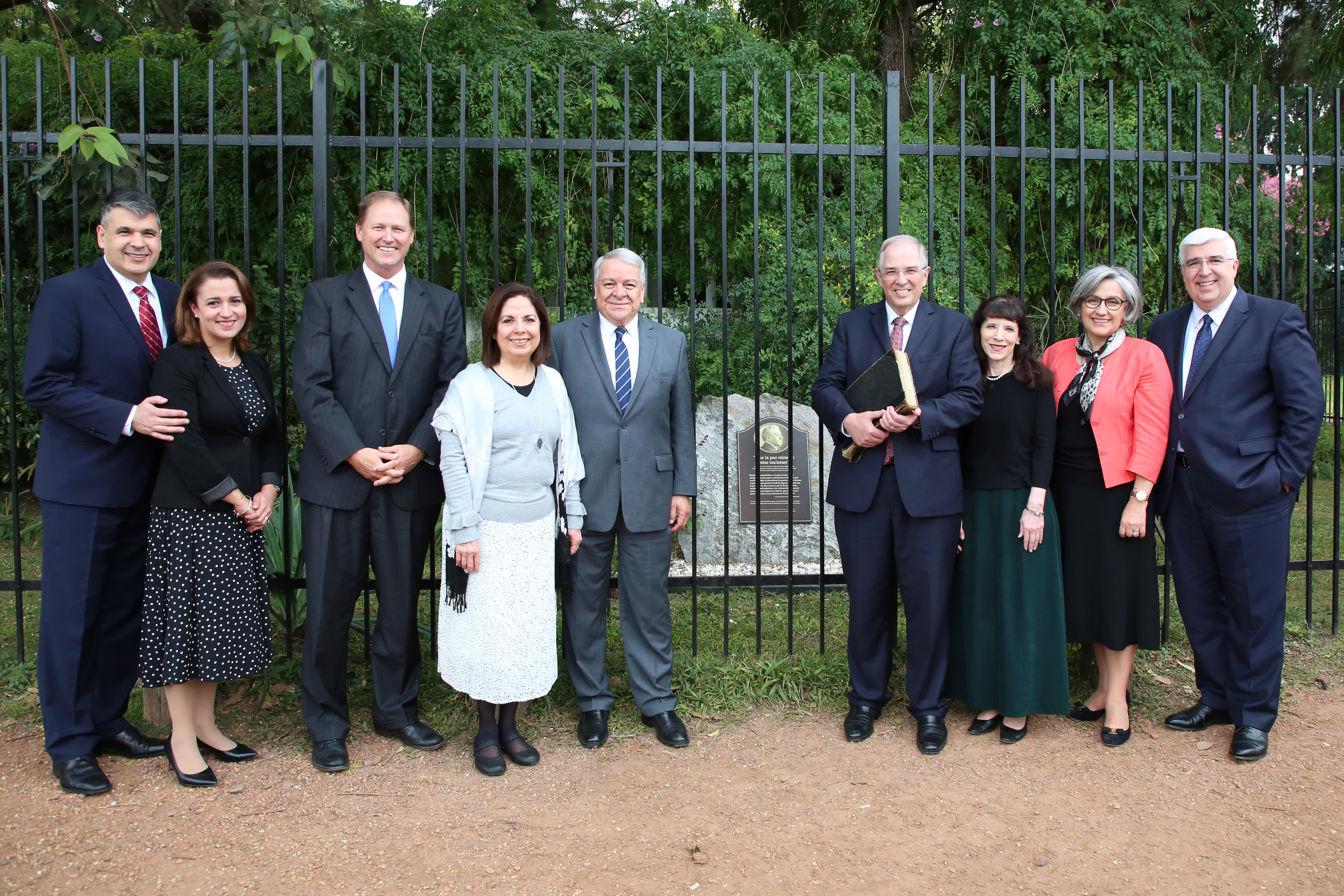Elder Neil L. Andersen and Sister Kathy Andersen visit Buenos Aires, Argentina, with Elder José A. Teixeira and Sister Maria Teixeira and the South America Area presidency and their wives — Elder Benjamín De Hoyos, center left, and Sister Evelia De Hoyos, Elder Mark A. Bragg and Elder Juan Pablo Villar and Sister Carola Villa. They stand at the spot where Elder Melvin J. Ballard blessed the land of South America in 1925. Elder Andersen's is holding a book of history, including the decision in 1925 to open the South American Mission.
