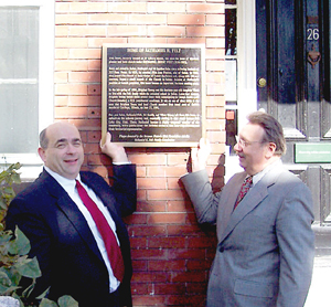 Jonathan C. Felt, left, great-great-grandson of Nathaniel H. Felt, and Kim R. Wilson display newly dedicated plaque on Felt home.