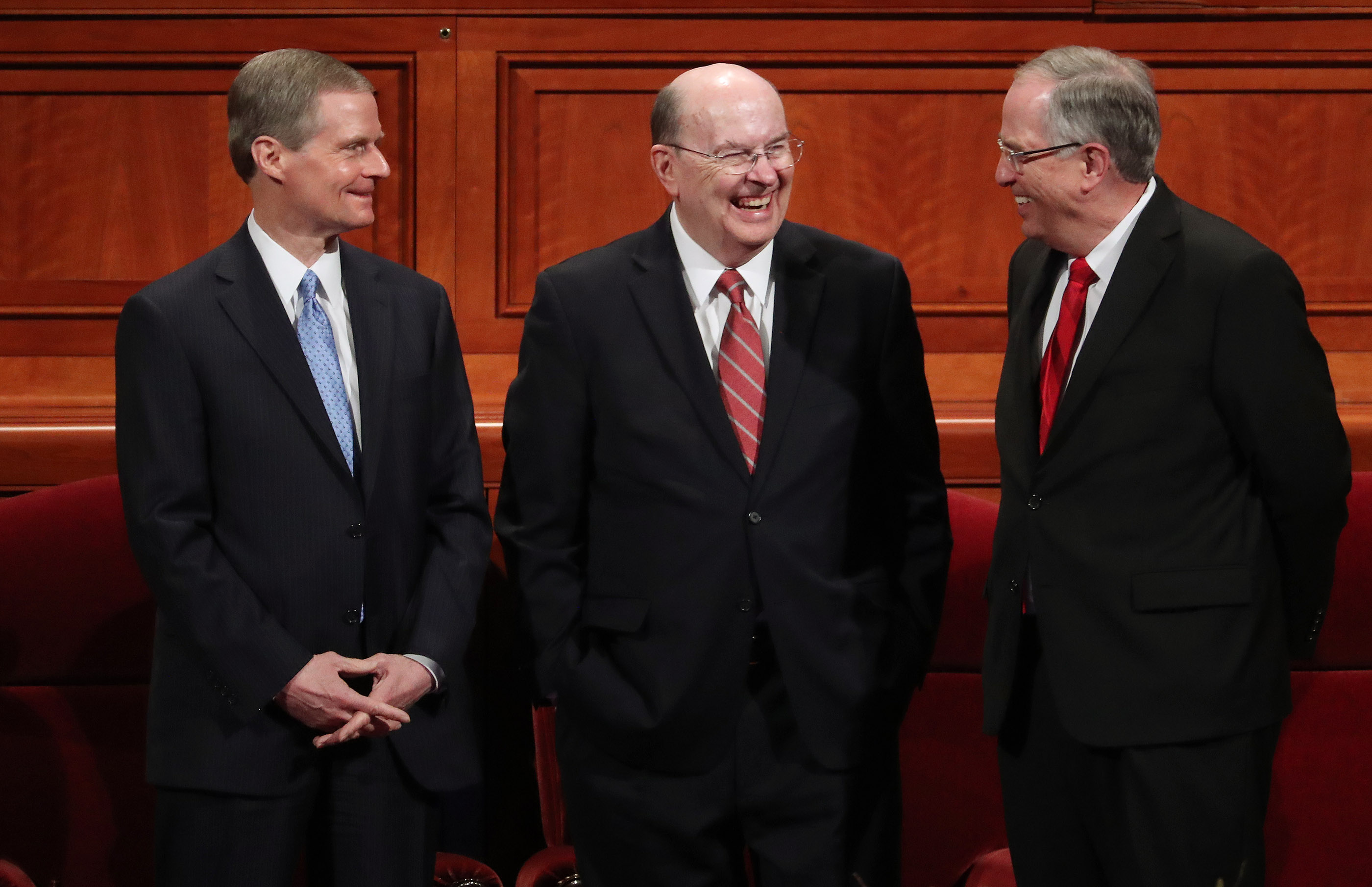 Elder David A. Bednar, Elder Quentin L. Cook and Elder Neil L. Andersen of The Church of Jesus Christ of Latter-day Saints' Quorum of the Twelve Apostles speak prior to the 189th Annual General Conference of The Church of Jesus Christ of Latter-day Saints in Salt Lake City on Saturday, April 6, 2019.