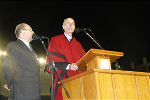 President Henry B. Eyring, first counselor in the First Presidency, dons a traditional Argentine poncho as he delivers remarks of encouragement to young people of the Church in Argentina prior to the performance.