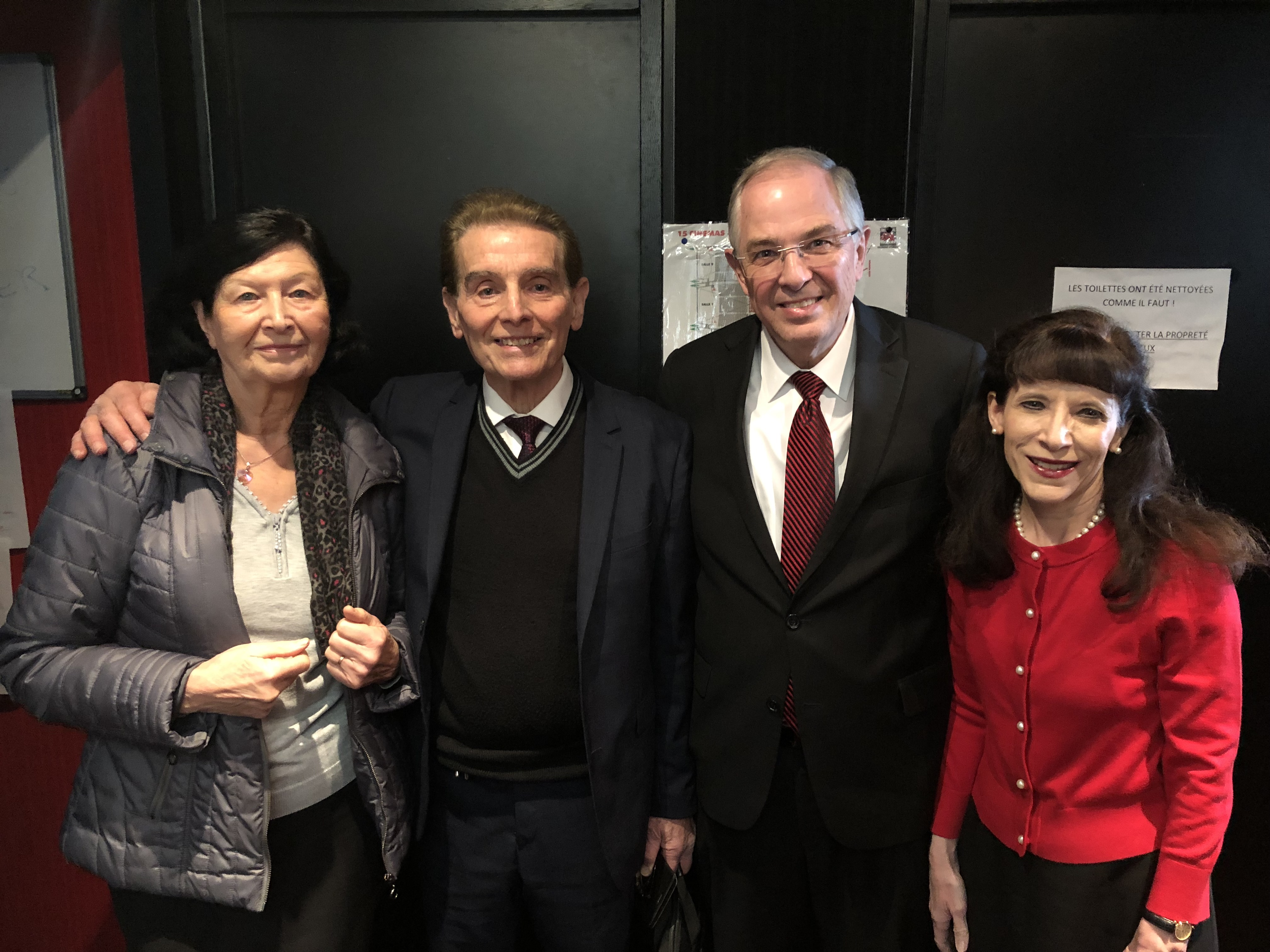 Marie-Blanche and Jean Caussé stand with Elder Neil L. Andersen and Sister Kathy Andersen. Brother and Sister Caussé are the parents of Presiding Bishop Gérald Caussé and Elder and Sister Andersen's former branch president.