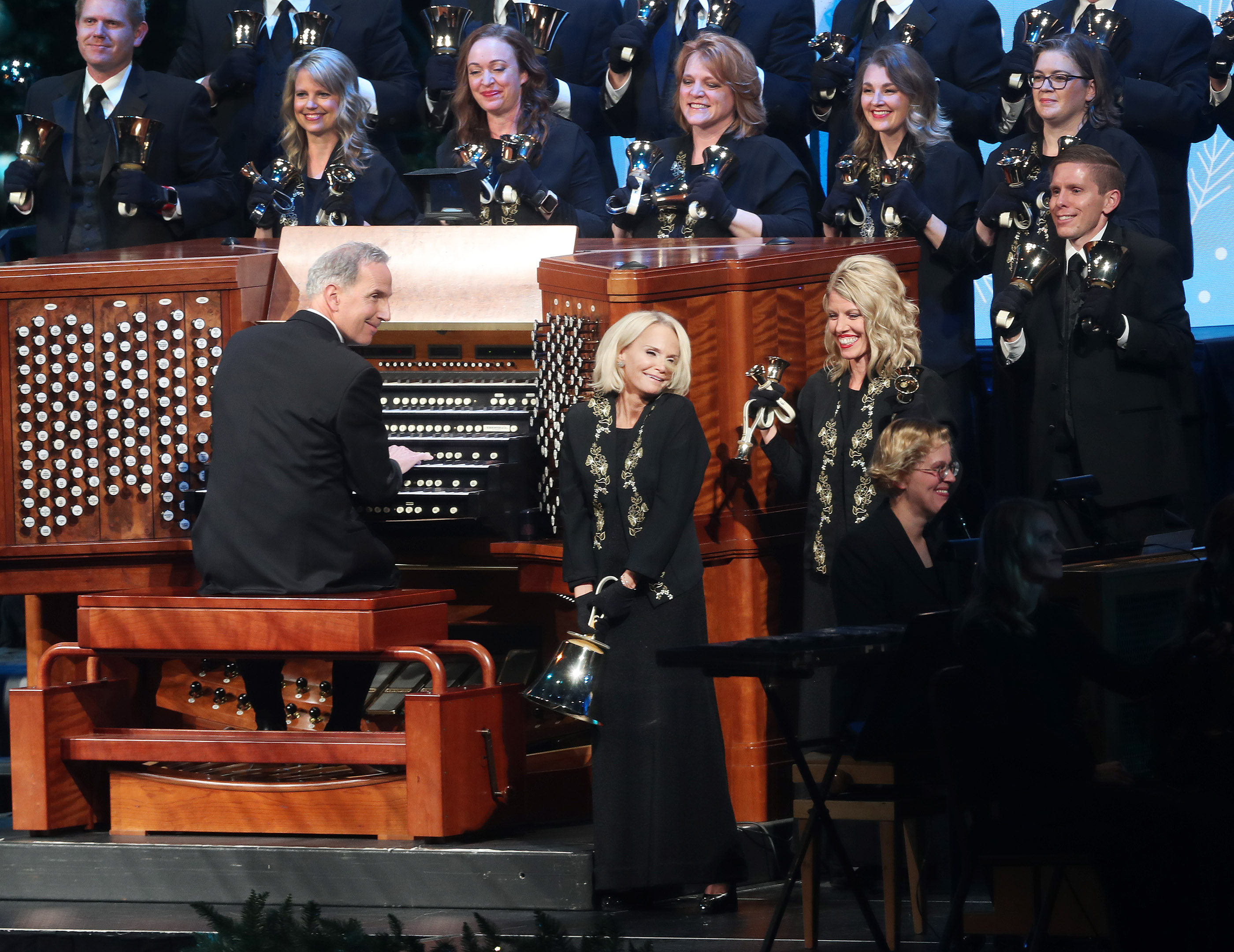 Kristin Chenoweth rings a large bell while playing with organist Richard Elliot and Bells on Temple Square during their opening Christmas concert at the Conference Center in Salt Lake City on Thursday, Dec. 13, 2018.