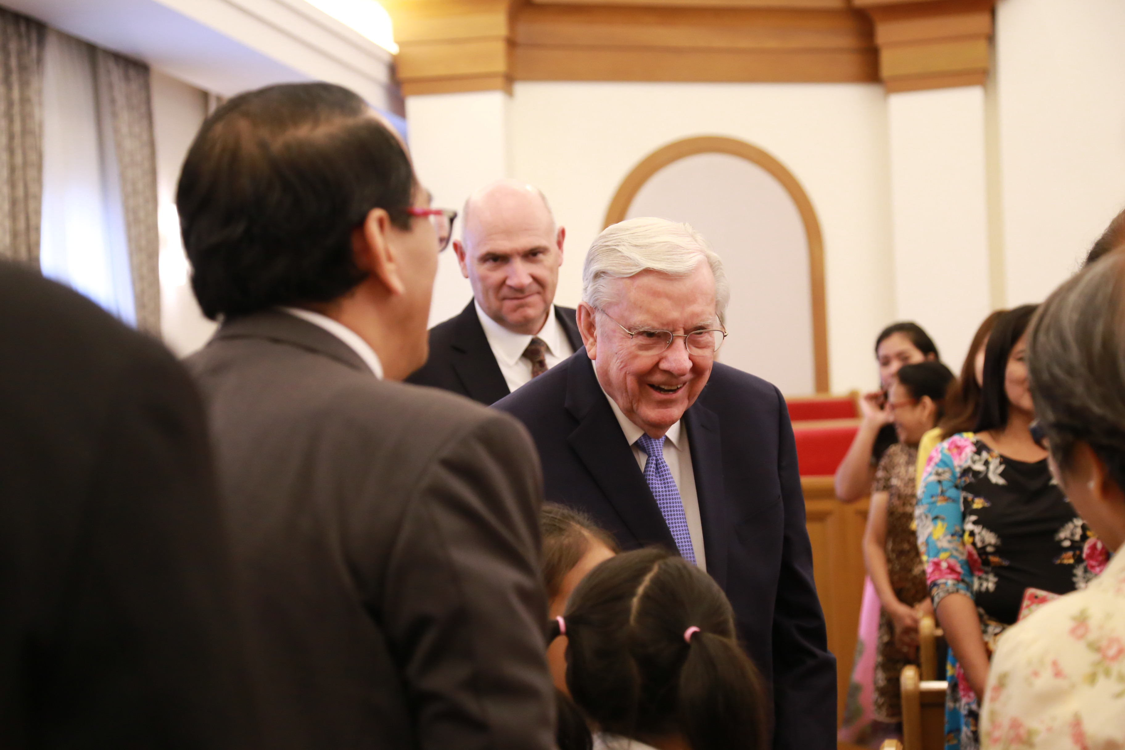 President M. Russell Ballard speaks with members at a stake conference in the Thailand Bangkok North Stake in May 2019.