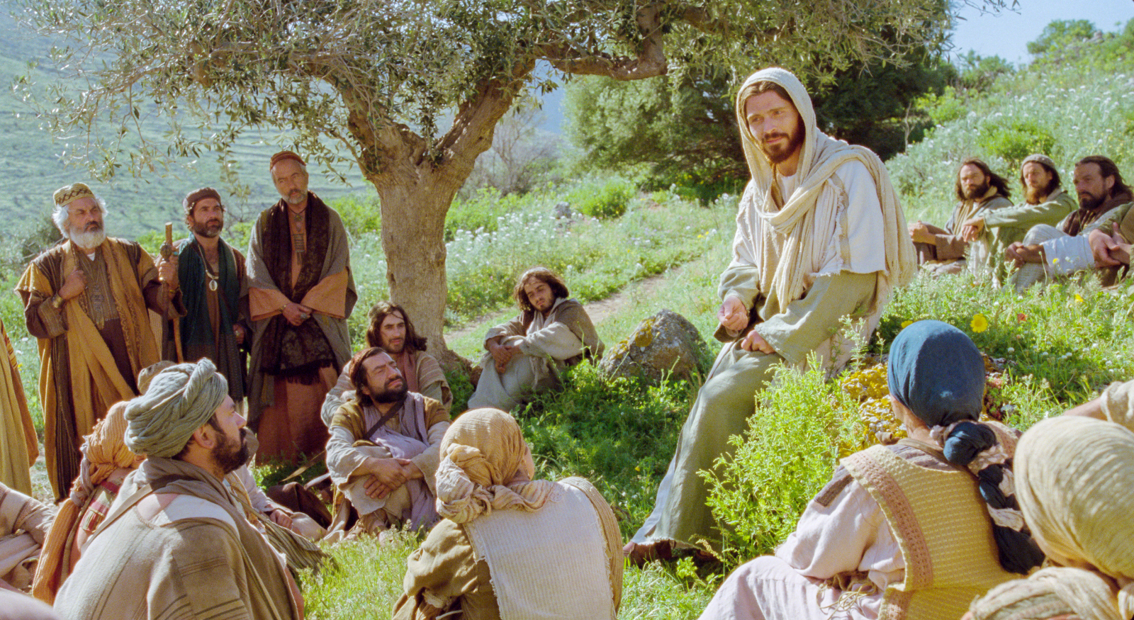 An image from the Church's Bible video series depicts Jesus teaching a group of people.