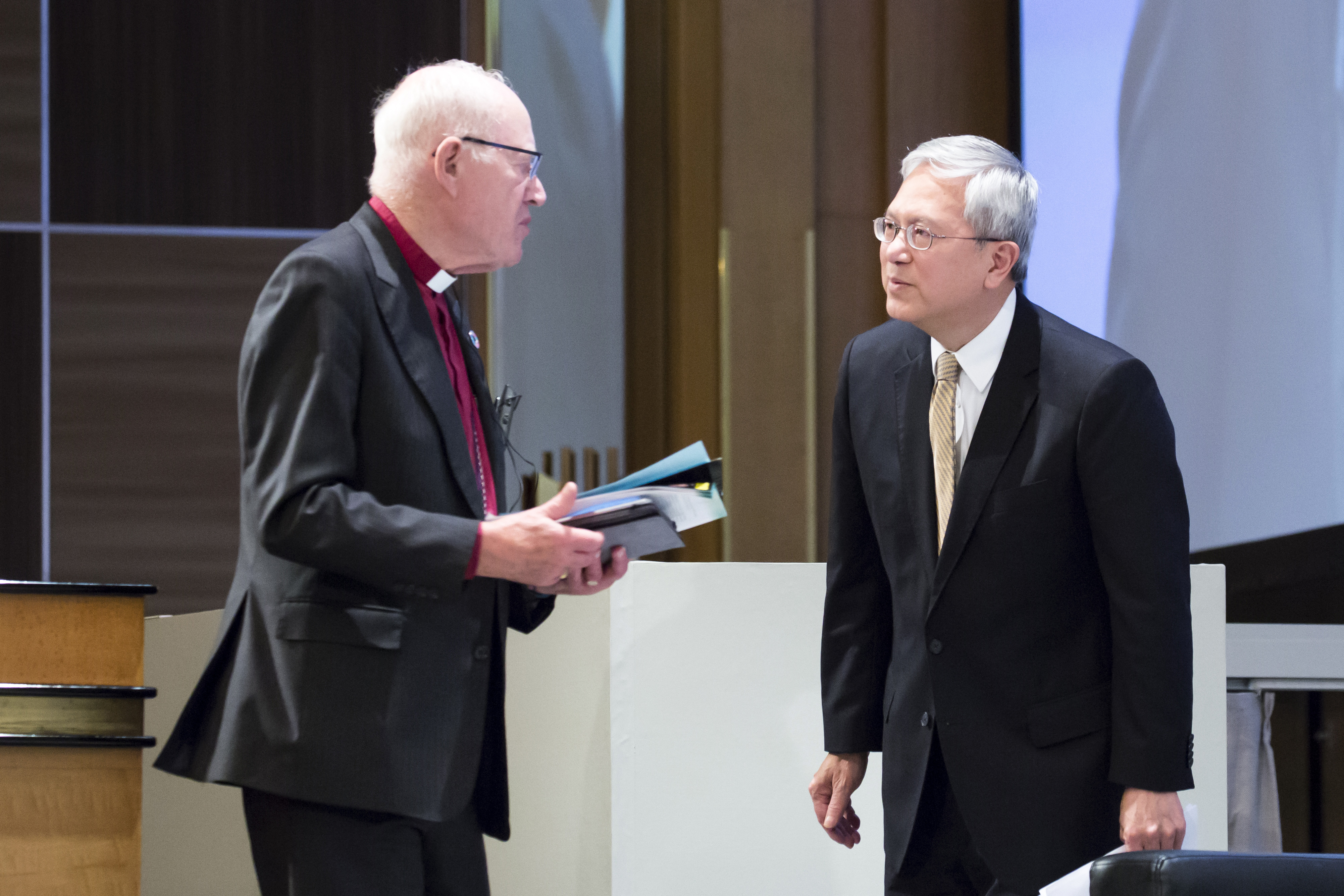 Elder Gerrit W. Gong of the Quorum of the Twelve Apostles of The Church of Jesus Christ of Latter-day Saints, right, speaks to Lord Carey of Clifton as he arrives for a session during the G20 Interfaith Forum in Chiba, Japan, on Saturday, June 8, 2019.