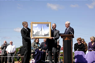 Groundbreaking for Kansas City Missouri Temple held on Saturday, May 8, 2010 Monday. Elder Donald D. Deshler, Area Authority, left, Elder Ronald A. Rasband of the presidency of the Seventy, and Elder William R. Walker of the Seventy display architect's rendering of new temple.