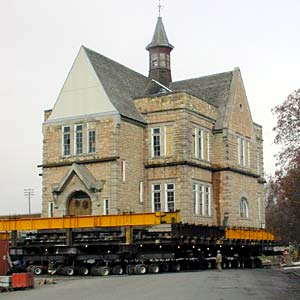 The Oneida Stake Academy building rolls on 41 hydraulic dollies down a street in Preston, Idaho, to its new home at Benson Park. The move on Dec. 10 represents years of efforts to save the structure.