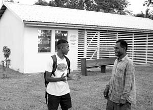 Rocky and Raul Serveux and their family of the Mele Branch, Port Vila District, reside next to small meetinghouse, which they help to maintain.
