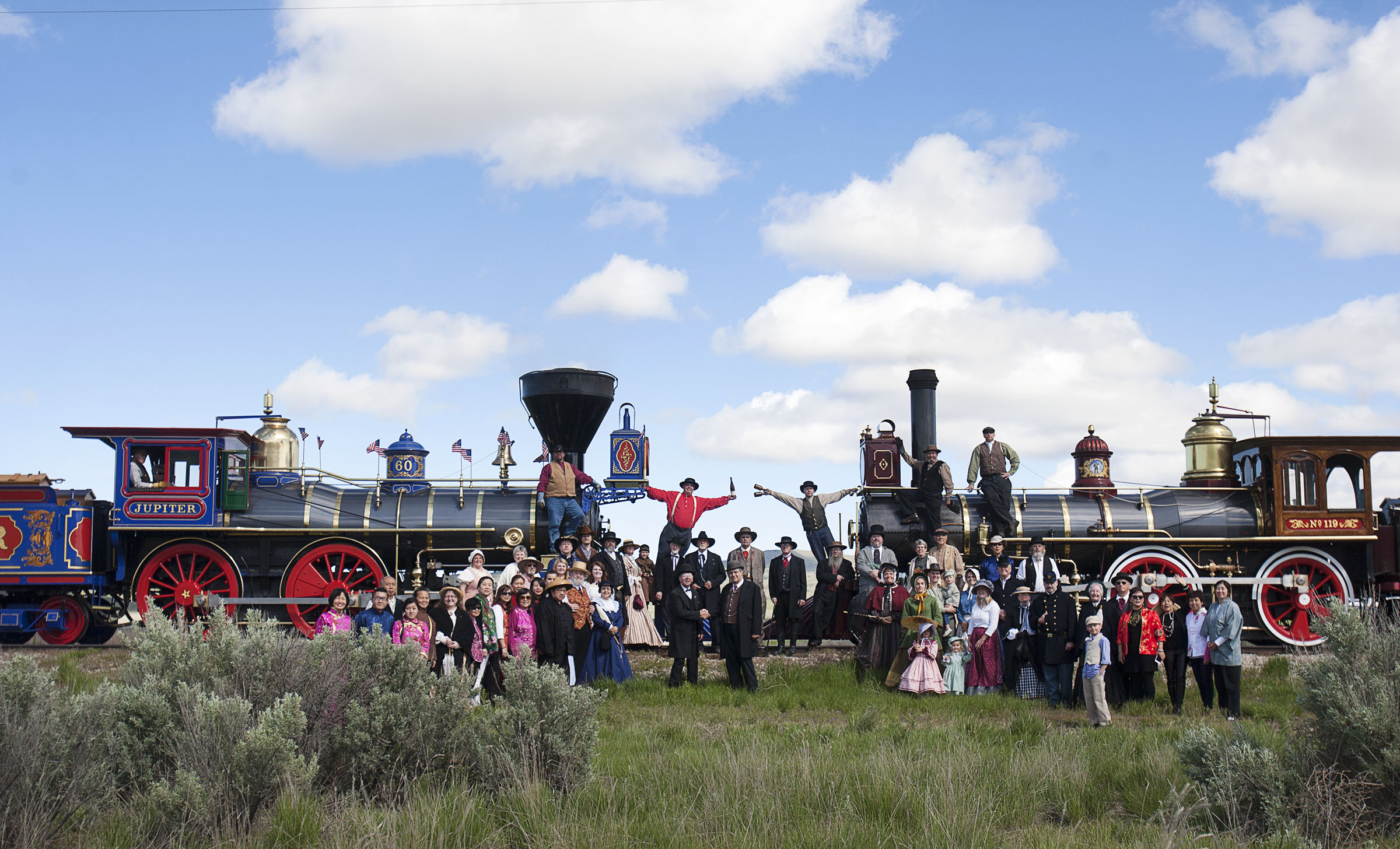 People in costumes pose for the reenactment photo at the golden spike commemorative ceremony in Brigham City, Tuesday, May 10, 2016.