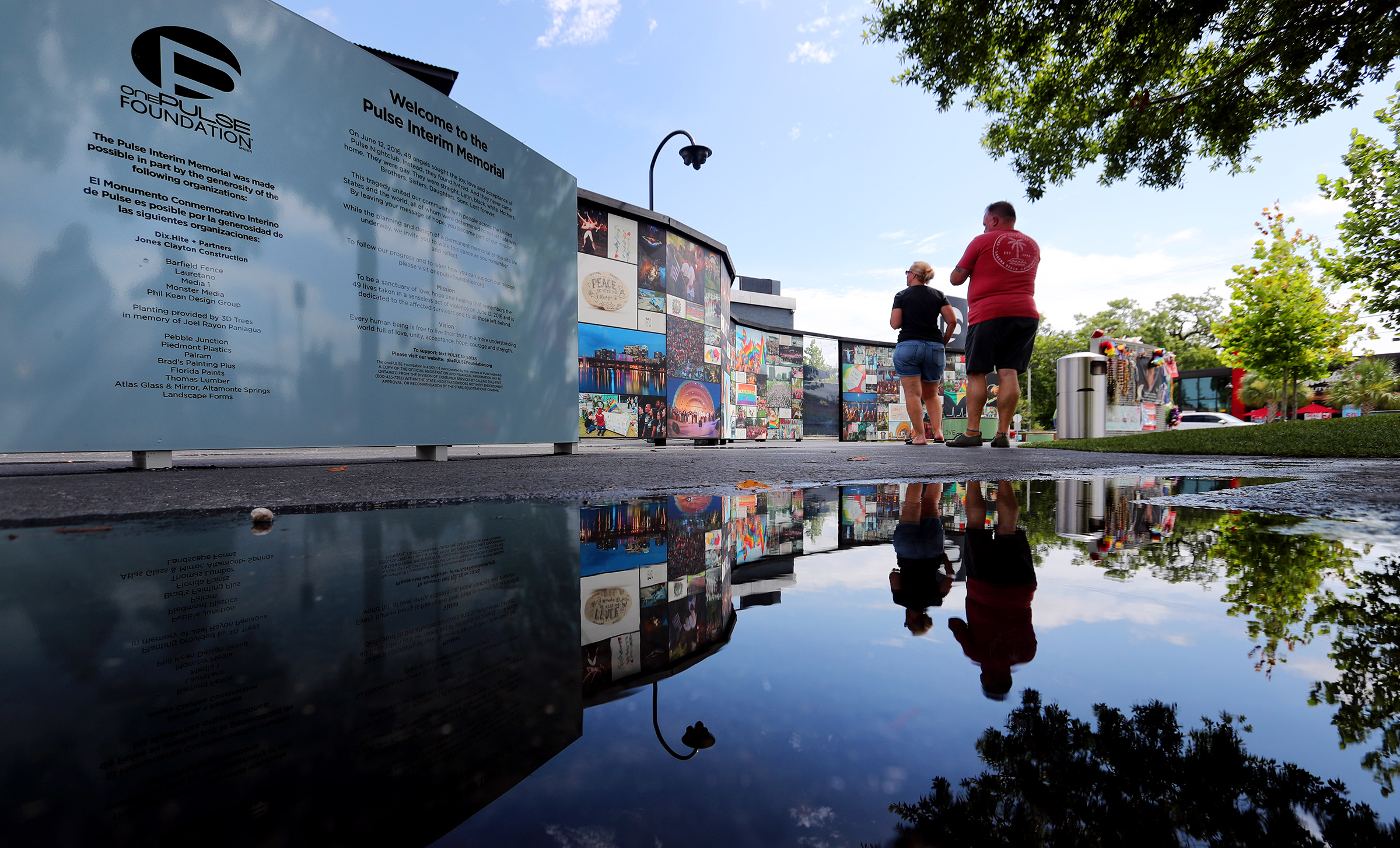 Visitors look at memorials left at the Pulse Nightclub in Orlando, Florida, on Sunday, June 9, 2019.