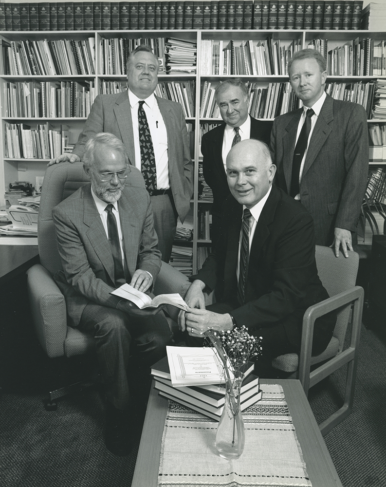 From left, John Langmore; Keith Nielsen, Sydney Stake Mission President; Arnold Cummins, Camberra District President; Slade Beard, Camberra District Director of Public Affairs; Elder Dallin H. Oaks, Quorum of the Twelve Apostles. Photo depicts handover of Encyclopedia of Mormonism and scriptures.