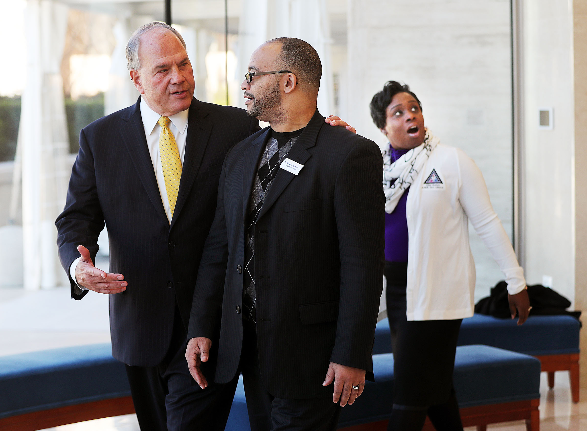 Elder Ronald A. Rasband, left, of The Quorum of the Twelve Apostles of The Church of Jesus Christ of Latter-day Saints, talks with Pastor Chris Zacharias of the John Wesley A.M.E. Zion Church as they tour the Rome Temple Visitors' Center on Tuesday, Jan. 15, 2019. Behind them, Pastor Zarharias' wife Kim looks at the Christus statue.