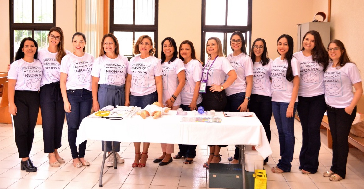Instructors from the Society of Childhood Pediatrics of Maranhao stand with neonatal care equipment donated by the Church.