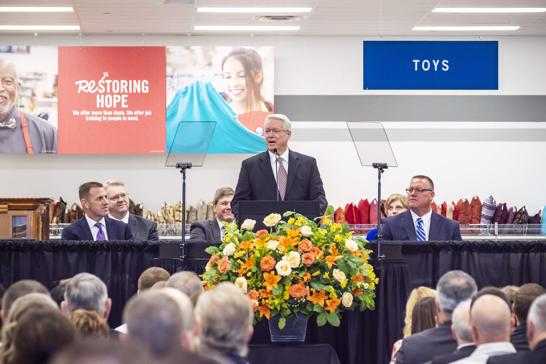 Bishop Dean M. Davies of the Presiding Bishopric of The Church of Jesus Christ of Latter-day Saints speaks at the dedication of the new Deseret Industries facility in Gilbert, Arizona, Oct. 20, 2018.