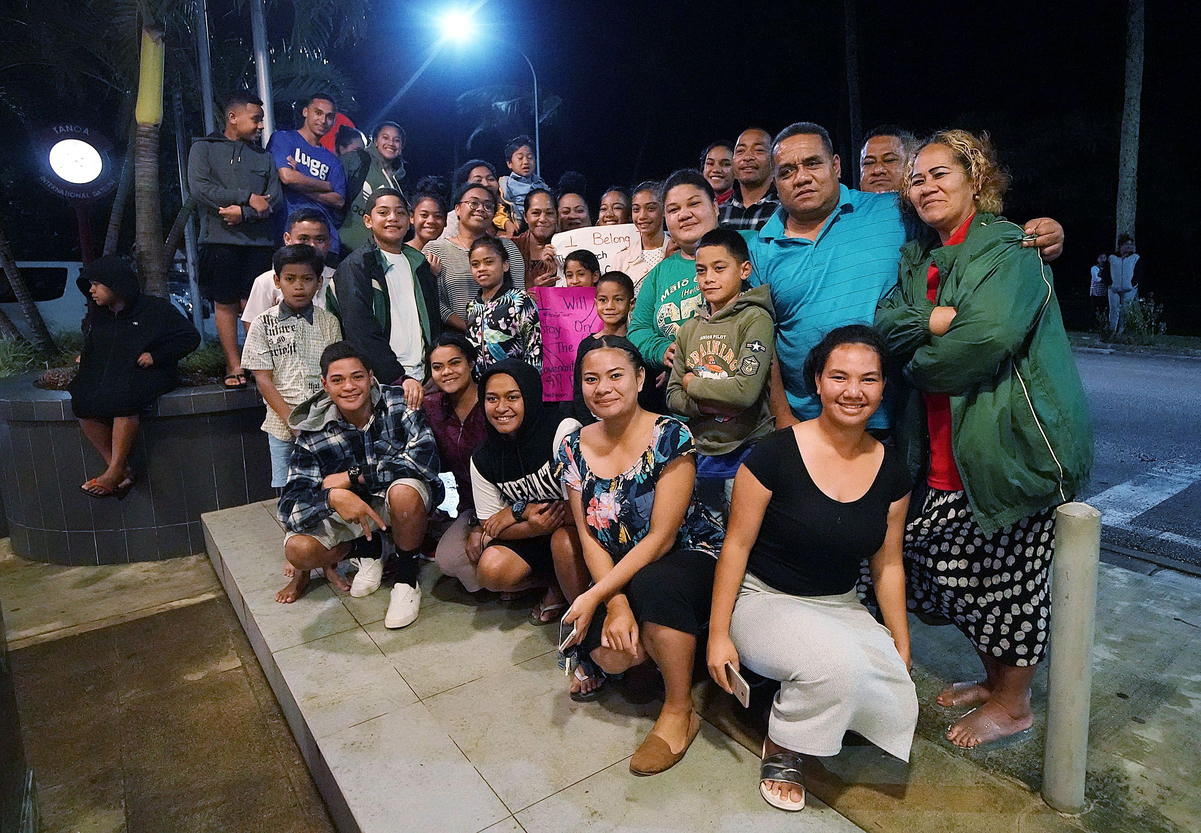 A group waits outside the hotel where President Russell M. Nelson of The Church of Jesus Christ of Latter-day Saints, and his wife, Sister Wendy Nelson, are staying in Nuku'alofa, Tonga, on Wednesday, May 22, 2019.