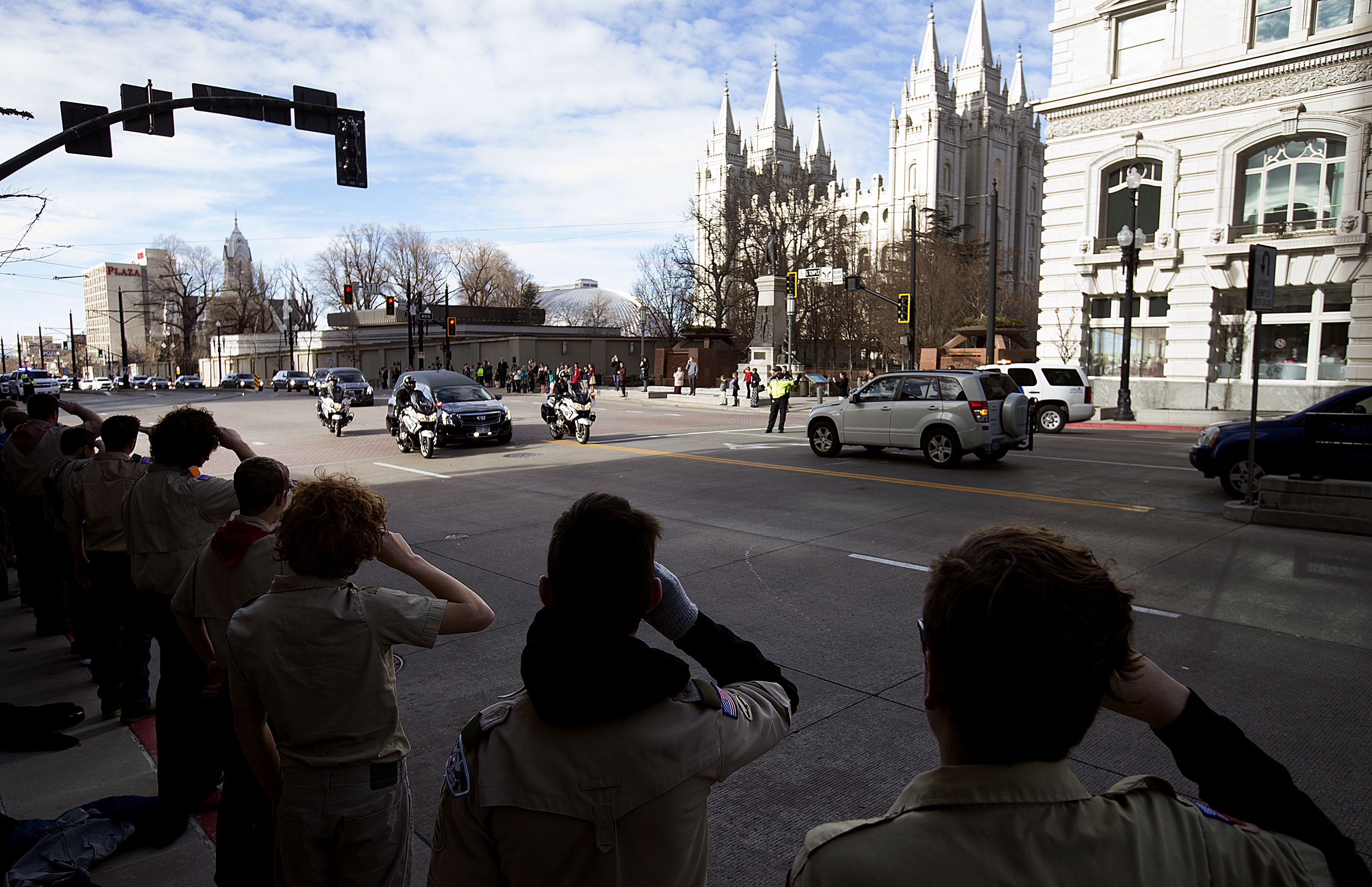 Mourners and Boy Scouts line South Temple as the funeral procession for Church President Thomas S. Monson makes its way to the Salt Lake City Cemetery on Friday, Jan. 12, 2018.