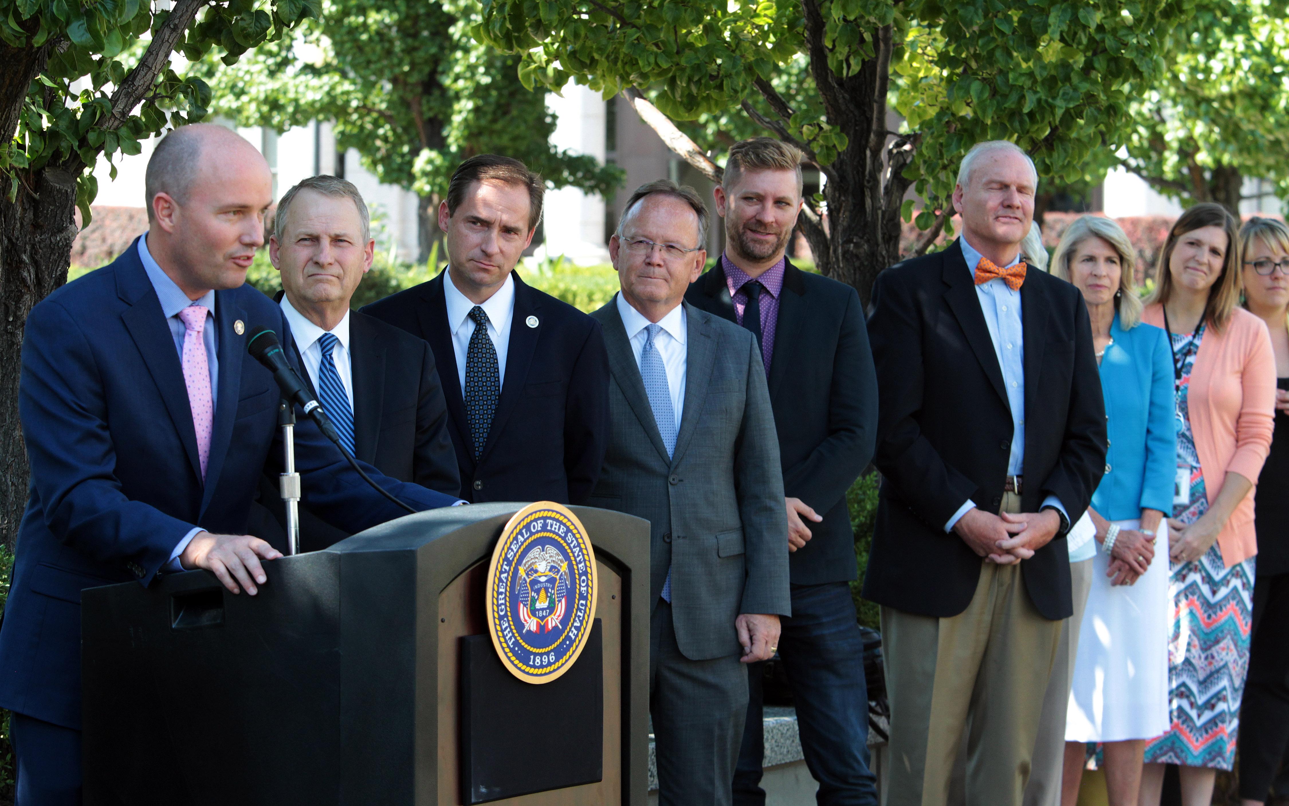 Utah Lt. Governor Spencer Cox, left, spoke at the news conference on suicide awareness, September 7, 2018.