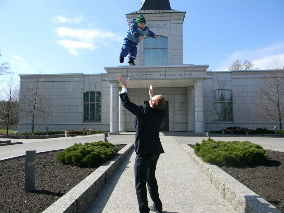 Konstantin Serebrennikov with his son, Roman, outside of the Helsinki Finland Temple. With no temple in Russia, Serebrennikov and his family make regular trips to Finland to visit the temple.