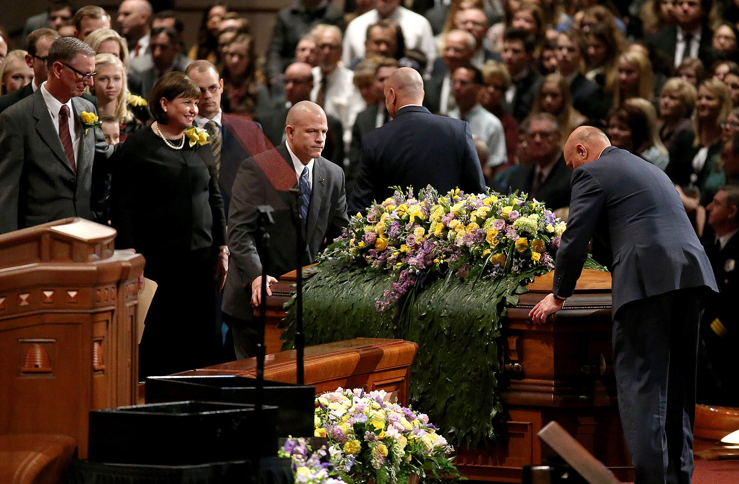 Members of President Thomas S. Monson's family watch as his casket is moved into the Conference Center in Salt Lake City on Friday, Jan. 12, 2018.