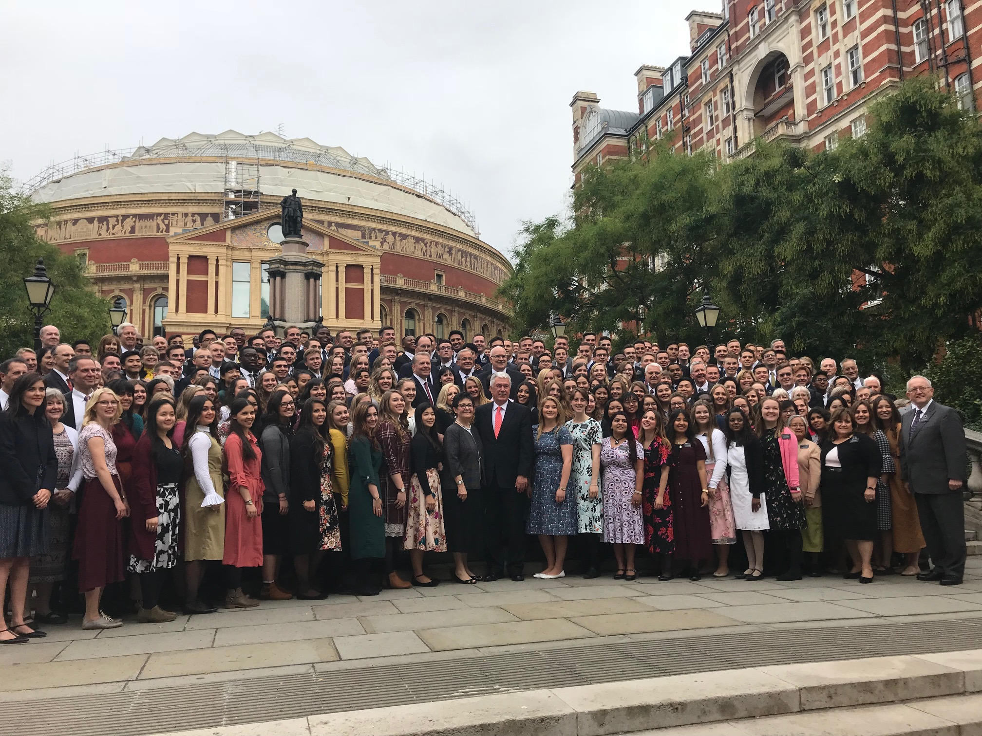 Missionaries and leaders of the England London Mission join Elder Dieter F. Uchtdorf of the Quorum of the Twelve Apostles, Sister Harriet Uchtdorf and other visiting general authorities for a mission photo outside London's Royal Albert Hall on Sept. 8, 2018.