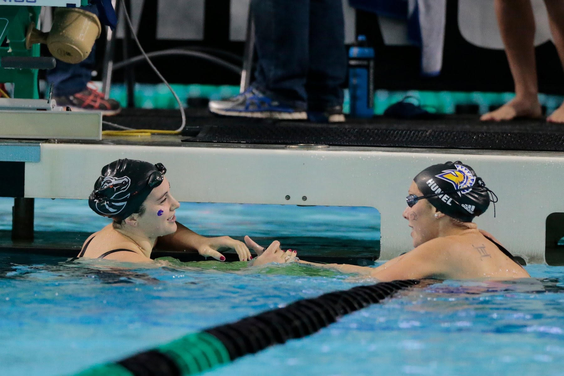 Boise State swimmer Abbey Sorensen, left, shakes hands with a San Jose State opponent following race.