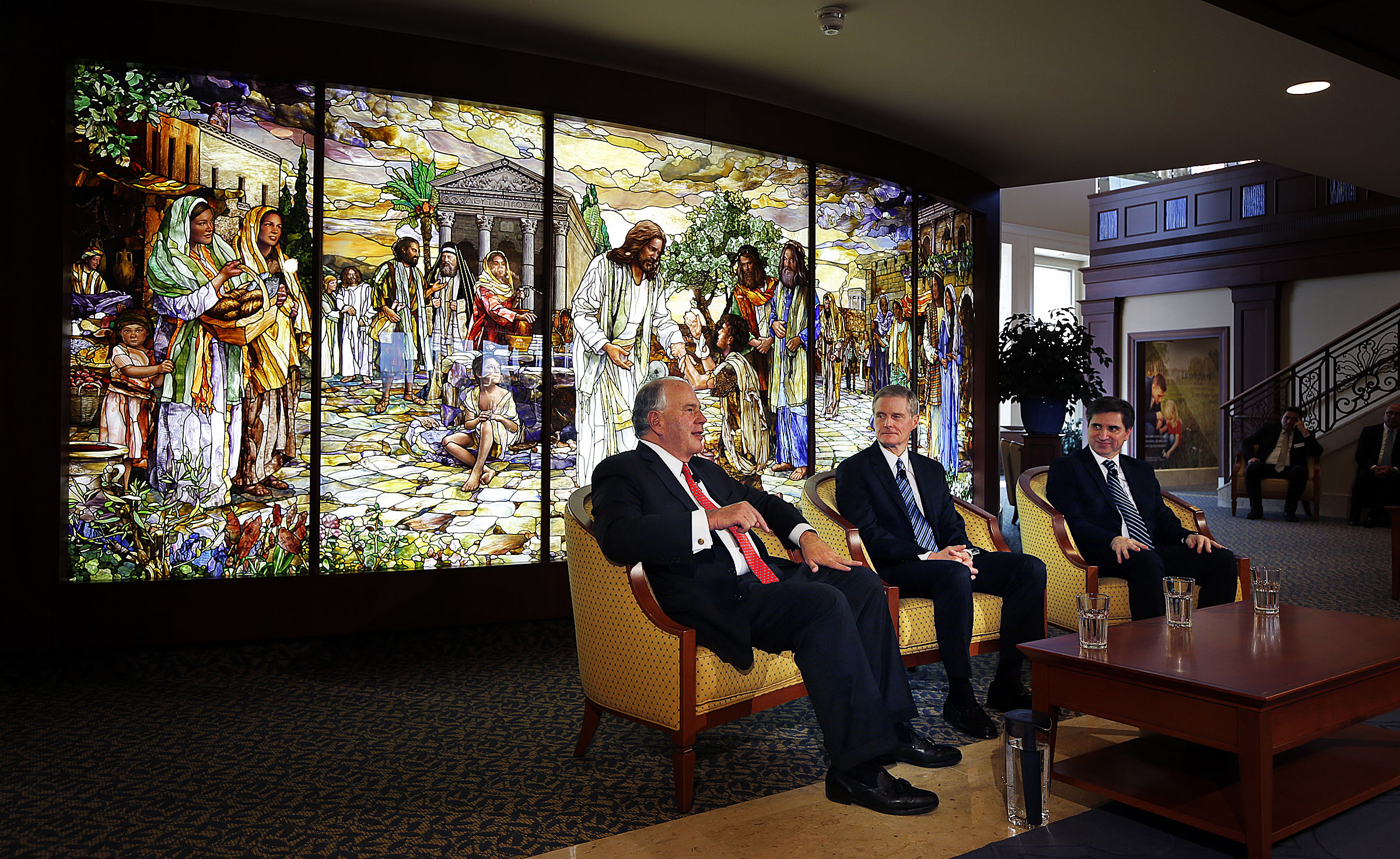 Elder Ronald A. Rasband, left, and Elder David A. Bednar of the Quorum of the Twelve Apostles, along with Elder Massimo De Feo, General Authority Seventy, participate in a press conference in the Rome Temple Visitors' Center of The Church of Jesus Christ of Latter-day Saints on Monday, Jan. 14, 2019.