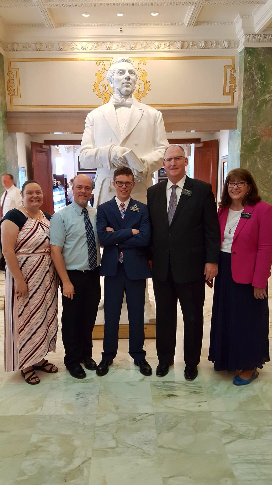 From left: Danyelle and John Ferguson, far left, drop off their son, Elder Isaac Ferguson, center, at the Utah Salt Lake City Headquarters Mission in 2018. Also pictured are President and Sister Fenn, far right, of the Utah Salt Lake City Headquarters Mission. Elder Ferguson is 19 and on autistic spectrum.