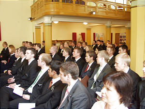 In historic meeting hall at Svartensgatan 3, where Swedish Mission was organized 100 yeas ago, current missionaries gather for celebration of mission centennial. The building, which has since been sold, served for many years as a meetinghouse.