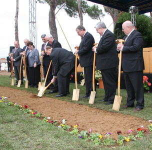 President Thomas S. Monson turns the first shovel at the groundbreaking ceremony.