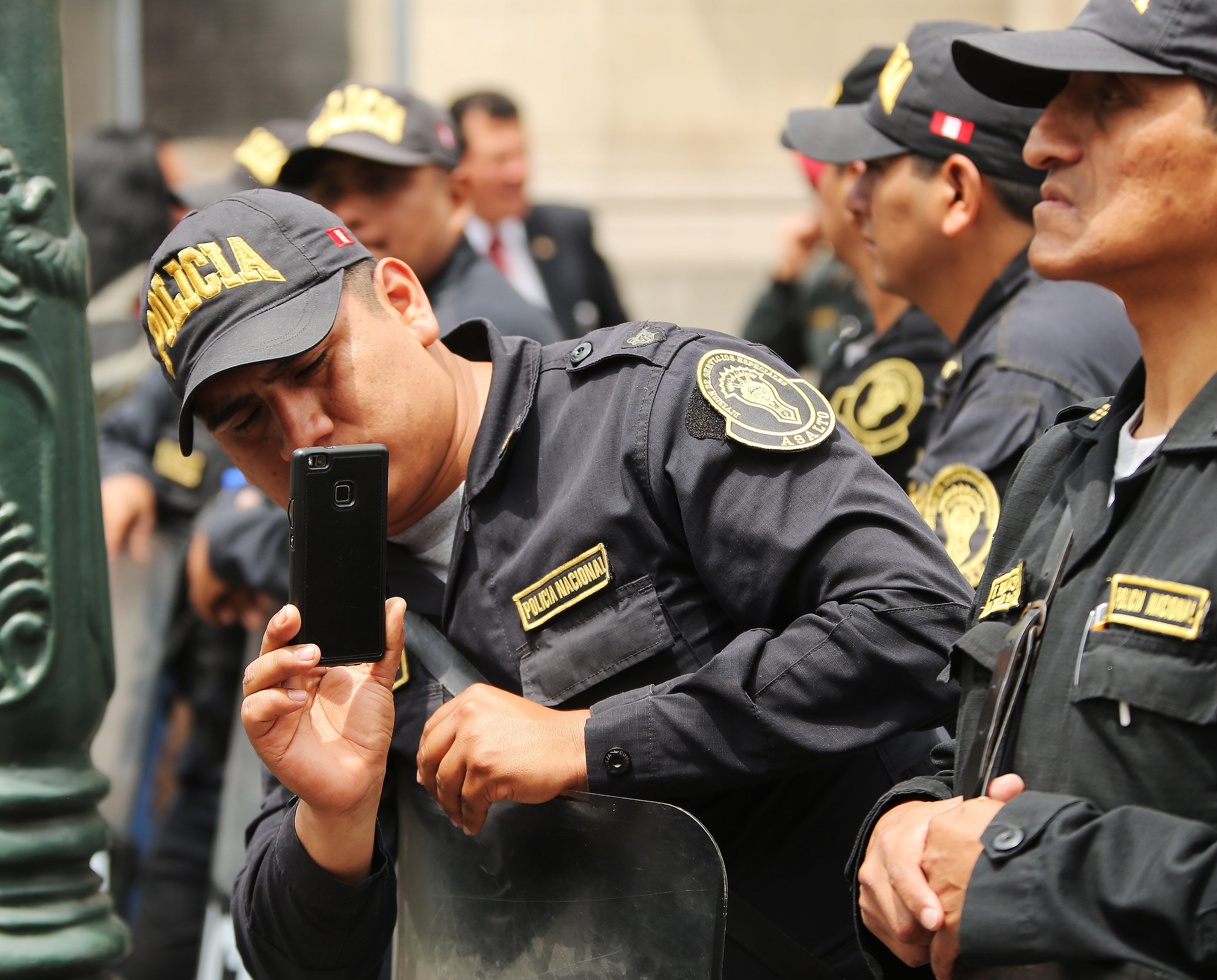 A policeman sneaks a photo of President Russell M. Nelson of The Church of Jesus Christ of Latter-day Saints in Lima, Peru, on Oct. 21, 2018.
