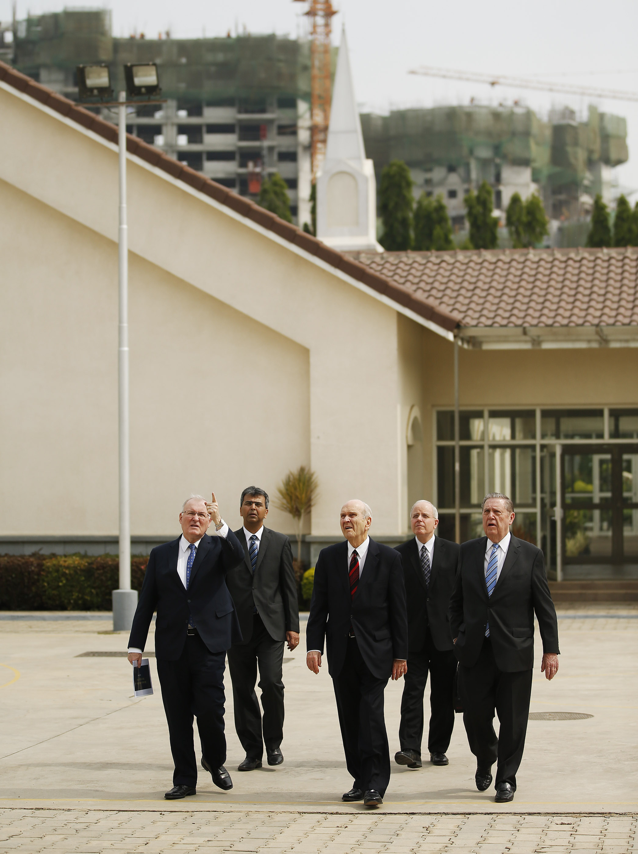 President Russell M. Nelson and Elder Jeffrey R. Holland of the Quorum of the Twelve Apostles, look over a possible temple site in Bengaluru, India on Thursday, April 19, 2018. They are accompanied by Elder Randy D. Funk, General Authority Seventy, and Elder Robert K. William, an Area Seventy.