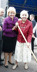 Claudia Kamor, 91, wields the shovel, assisted by her daughter Barbara Stankiewicz.