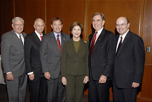 """Elder M. Russell Ballard, left, and Elder Quentin L. Cook, right, of the Quorum of the Twelve, met with former first lady Laura Bush and other business, government and educational leaders on Oct. 26 following the rededication of the University of Utah's J. Willard Marriott Library. Elder Ballard, Elder Cook and Mrs. Bush are joined by LDS businessman J.W. """"Bill"""" Marriott Jr., second from left, Utah Gov. Gary Herbert, third from left, and University of Utah President Michael Young."""